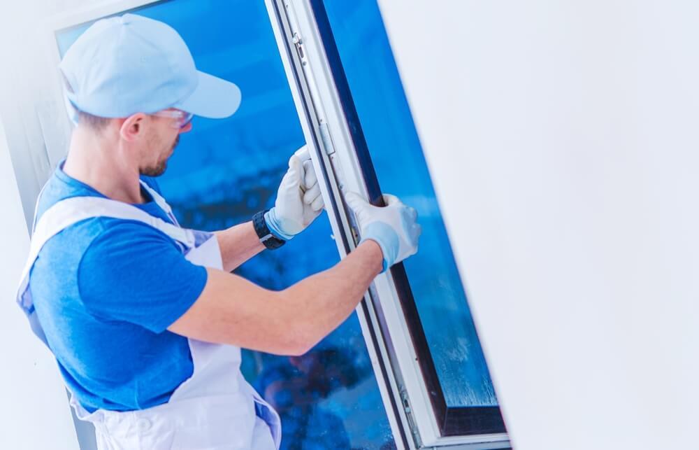 Window specialist installing a new window